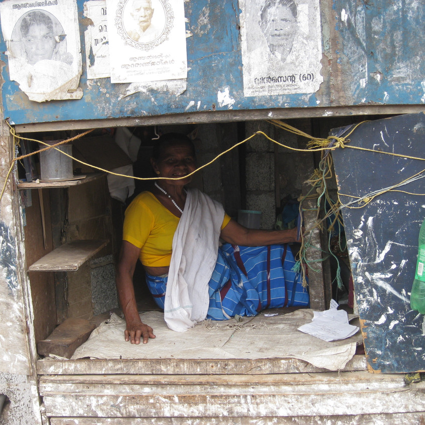 One of our beneficiaries in her home / shop