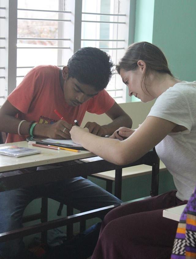 Emma helping SISP student Krishna
