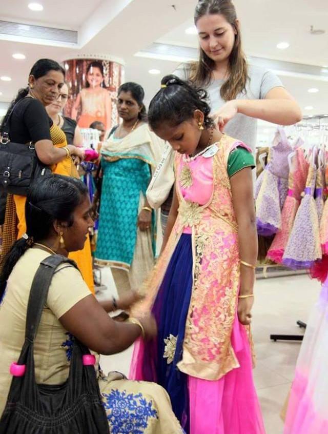 Sheeja choosing her dress