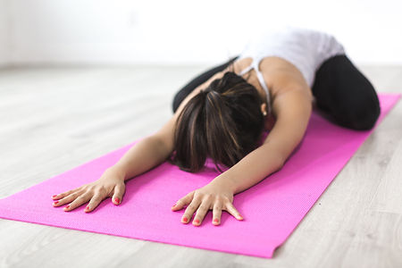 woman-doing-yoga-pose-on-pink-yoga-mat-3