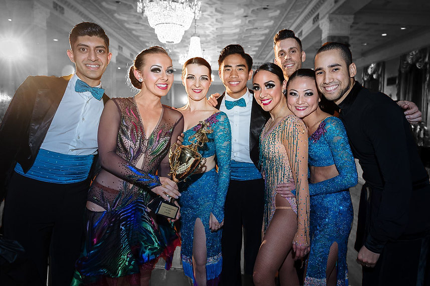 Salsa team champions with trophy