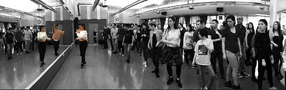 busy salsa class with instructors leading