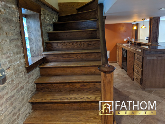 Basement_Stairs_and_Bar_with_Sink_and_Di