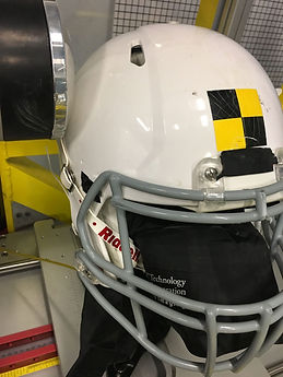 Football helmet in a lab setting with an HX-series impact sensor used for the design of helmets and protective equipment.