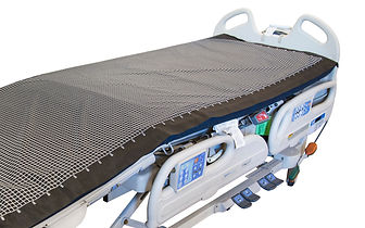 Hospital bed covered with XSENSOR's low-pressure PX100-series sensor for mattress and clinical surface design.