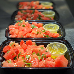 Individual containers of watermelon salad