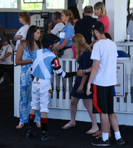 Nexus Members discussing the game plan before a race.