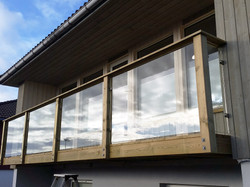 Glass-with-steel-holders-wooden-fence-6.