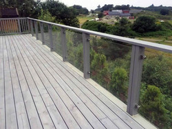 Glass-with-steel-holders-wooden-fence-5.