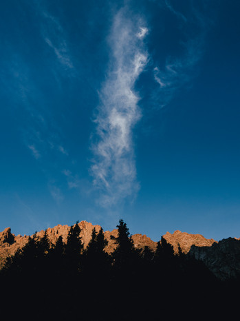 A long whisp of cloud at the Ak-Sai Gorge waterfall campground (Matt Horspool)