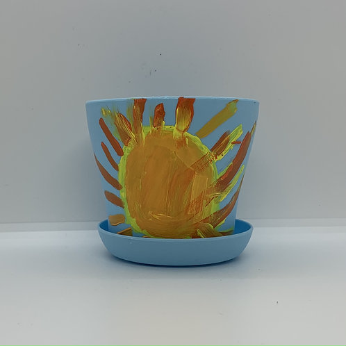 The sun hand painted on a 4 inch plastic pot and saucer