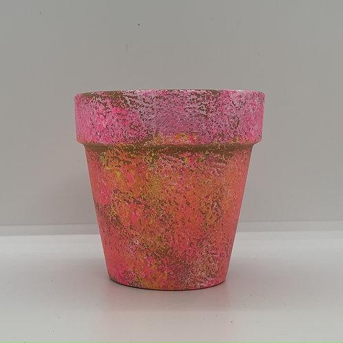 "Bright sponge""flowers"" on a 3 inch terra cotta pot"
