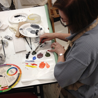 One of my students working on mixing from a limited palette. I encourage students to see how much color they can get from such few colors. Plus they all harmonize!
