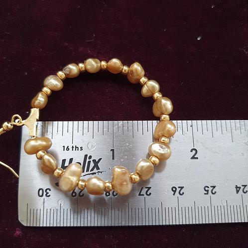 Gold coloured pearl hoop earrings