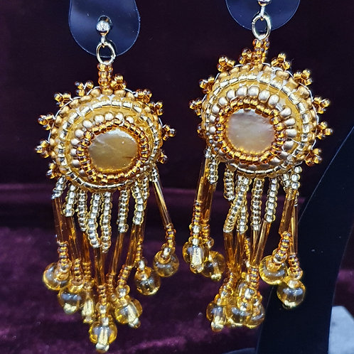 Golden pearl and bead fringed drop earrings