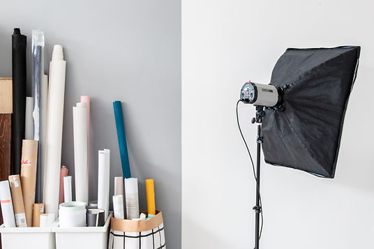 Photography studio light with soft box and backdrops