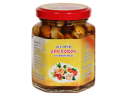 Assorted nuts in mountain honey
