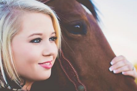 photo of a student with her horse