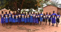Bulogo children  with solar  lamps_