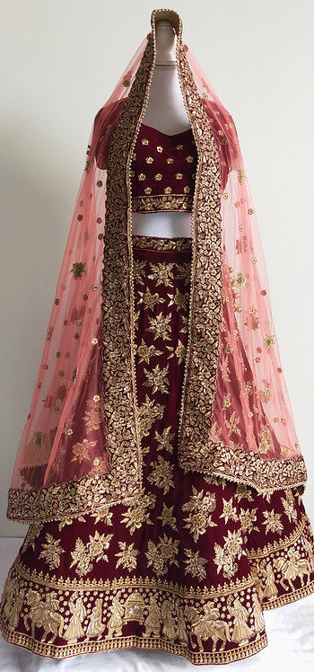 Stunning bridal lengha in maroon velvet with gold embroidery and ghajari stall