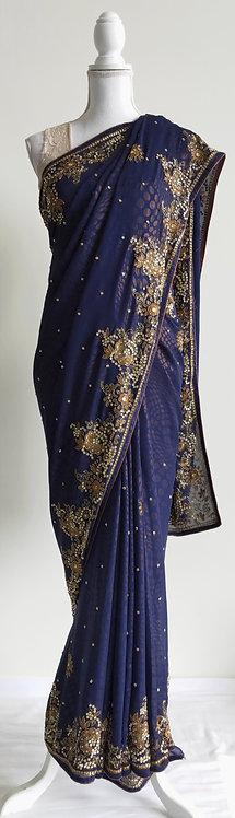Stunning metallic blue and gold patterned heavily embroided sari
