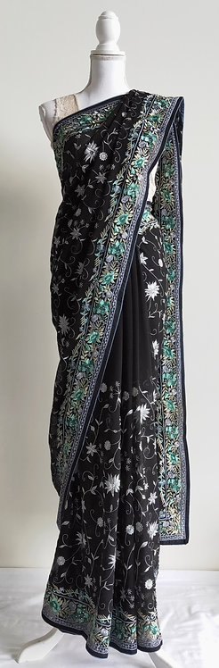 Beautiful black heavily embroided sari with mint green and silver border