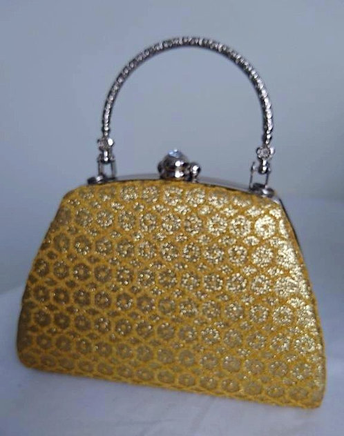 Beautiful gold design bag with solid handle