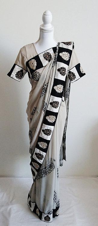 Stylish self pleated black and cream printed sari