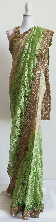 Gorgeous two toned beige and green self pleated net sari