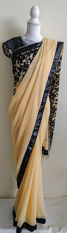 Stylish cream and black sari with floral pattern
