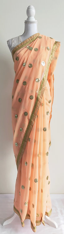 Lovely peach sari with gold sequin embroidery throughout