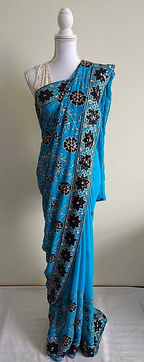 Aqua sari with black and gold floral beaded pattern throughout