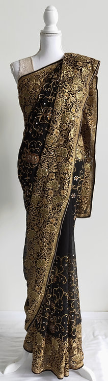 Beautiful black and gold heavily embroided wedding sari