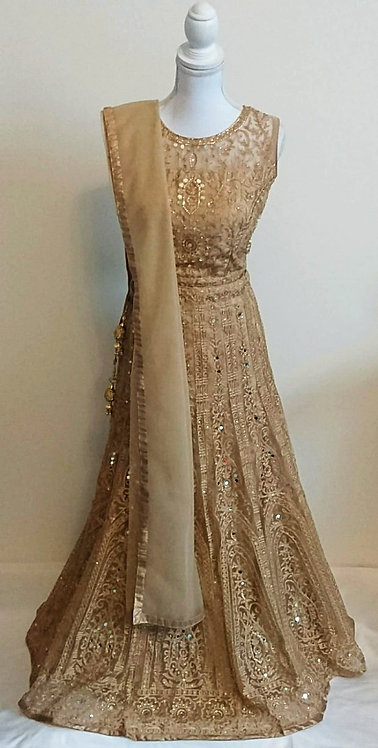 Glittering gold three piece lengha with mirror embellishments