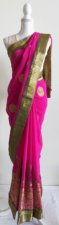 Stunning magenta crepe sari with gold embroided pattern and stone work