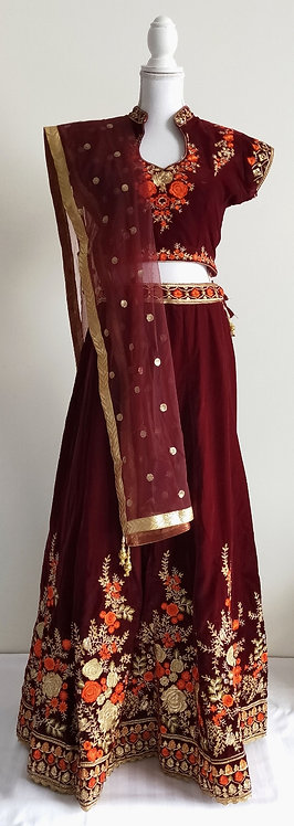 Stunning wine velvet lengha with orange and gold floral threadwork design