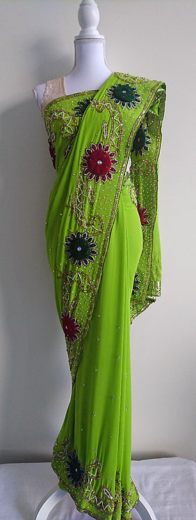 Beautiful lime green sari with heavily embroidered velvet and beaded border