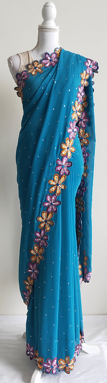 Stylish blue sari with pink and orange floral border