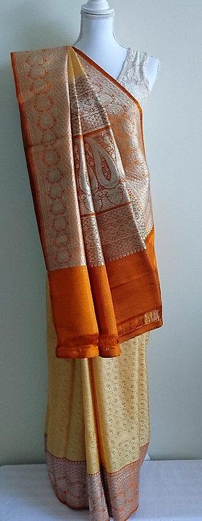 Yellow patterned pure silk sari with orange zari embroided pallu