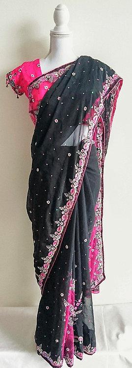 Gorgeous black sari with dark pink borders and heavy stone work