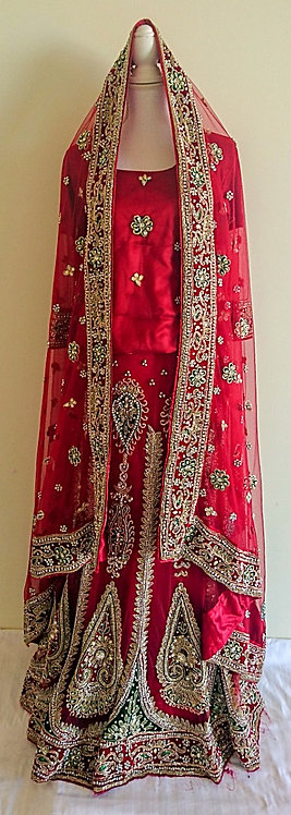 Beautiful red bridal lengha with heavy stone work