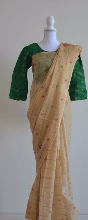 Beige georgette sari with red,green and gold embroidery