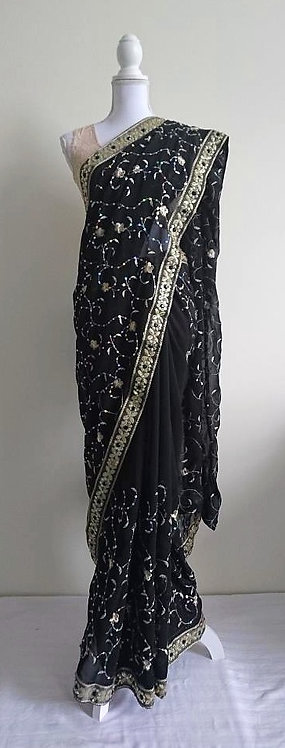 Stylish jet black sari with gold floral embroidery throughout