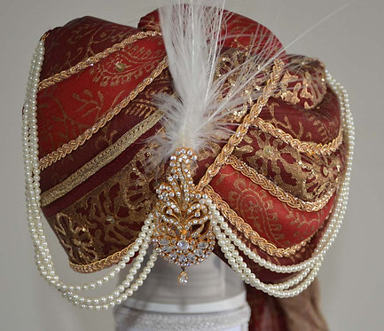 Cream and red wedding turban with glittering feather broach