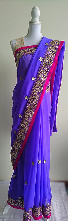 Stunning purple and pink georgette sari with heavy gold border