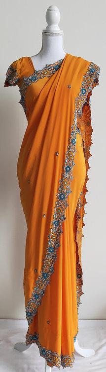 Stunning orange sari with delicate blue border
