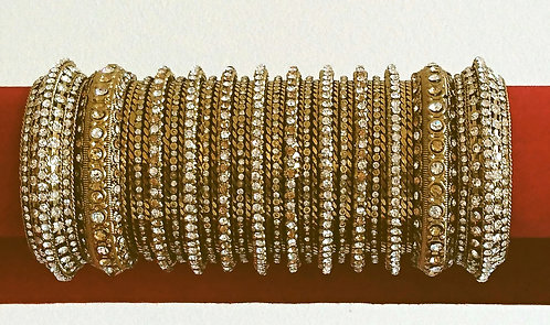 Beautiful two hand set of gold and silver diamonte bangles