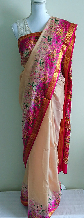 Beautiful pure silk cream sari with delicate pink and gold embroidery
