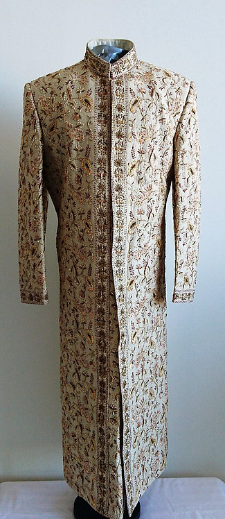 Designer beige wedding sherwani with red and gold embroidery throughout