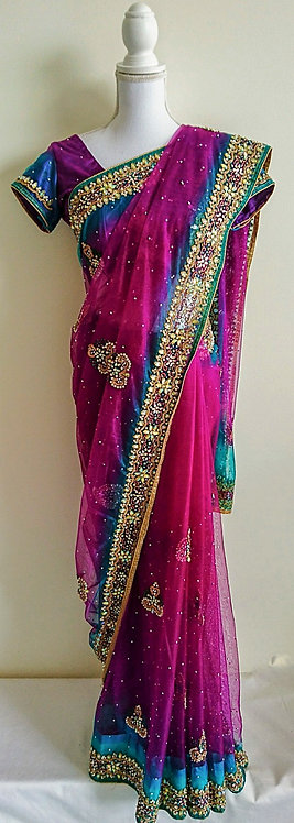 Stunning purple and blue net sari with heavy stone work border